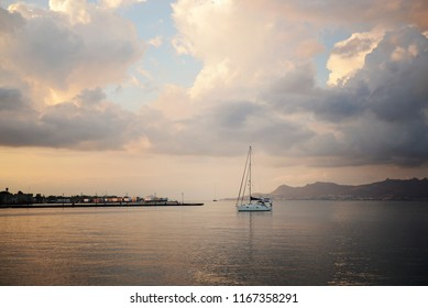 Sailboat on a sea in sunset. Greece