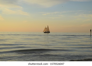 Sailboat in the open sea at dusk