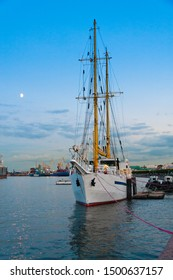 sailboat at the pier on the Neva river embankment, in the evening at sunset in St. Petersburg