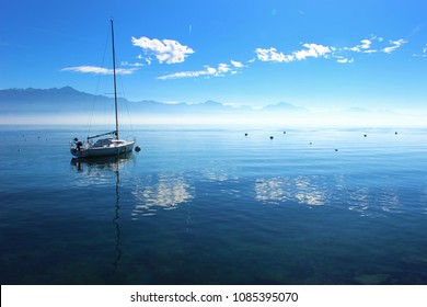 Sailboat reflection. Sailboat in Geneva lake or Lac Leman Lausanne, Switzerland