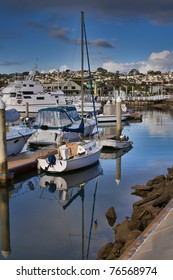 Sailboat and reflection in San Diego, CA