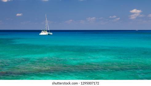 Sailboat resting on the Caribbean Sea in Grand Cayman