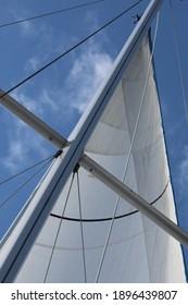 Sailboat rigging against blue sky