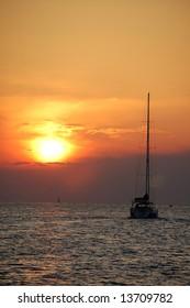 Sailboat sailing into the sunrise