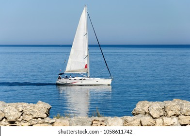 The sailboat sails offshore Tavric Chersonese. Sevastopol. Republic of Crimea.