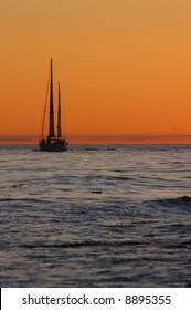 Sailboat Silhouette off the California Coast at Sunset