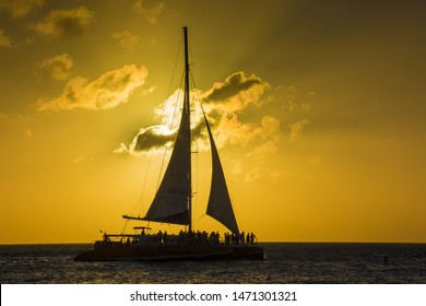 Sailboat silhouette at sunset in Aruba