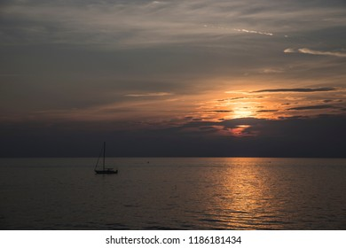 Sailboat stopping on the sea at sunset
