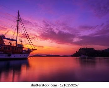 Sailboat at Sunrise on the bay of Nidri in Lefkas island Greece