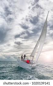 sailboat at sunset in navigation