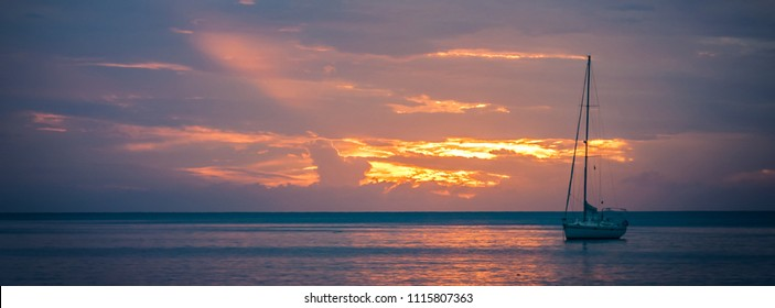 Sailboat at sunset, panorama