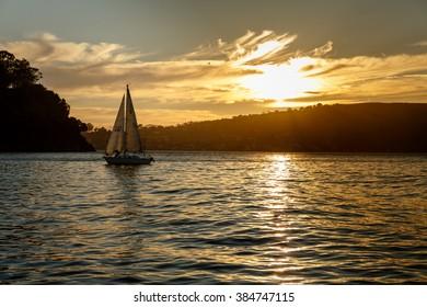 Sailboat at sunset in San Francisco Bay