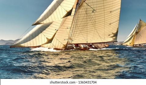 Sailboat under white sails at the regatta. Sailing yacht race
