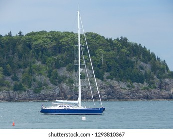 Sailboat without a sail anchored by Mount Desert Island off the coast of Bar Harbor, Maine.