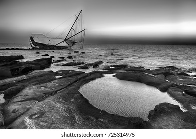 Sailboat Wreck, Yacht Rotted and ruined. Black and white photo