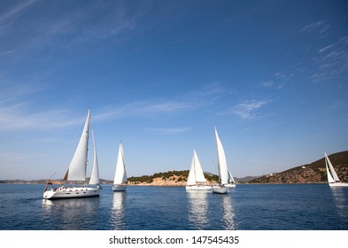 Sailboat. Yachting. Sailing. Travel Concept. Vacation. Regatta on the sea.