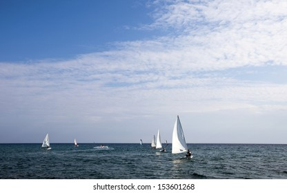 Sailboats in the Aegean sea with the blue sky