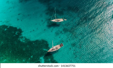 Sailboats from the air in crystal clear blue water, exotic vacation in a paradise, Caribbean Islands holiday