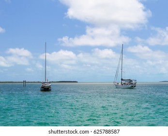 Sailboats anchored in Alice Town, in the Bimini islands, Bahamas.