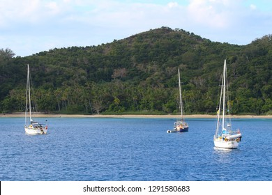 Sailboats anchored in a bay of the Sacred Islands, Mamanuca Islands, Fiji