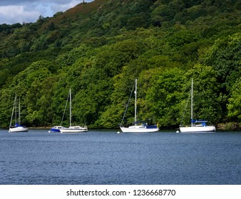 Sailboats anchored on Lake Windermere in the Lake District, England.