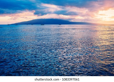 Sailboats Anchored At Sunset With The Island Of Lanai In The Background As Seen From The Lahaina Yacht Club On The Island Of Maui