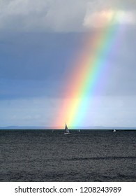 Sailboats and beautiful rainbow over the Irish Sea