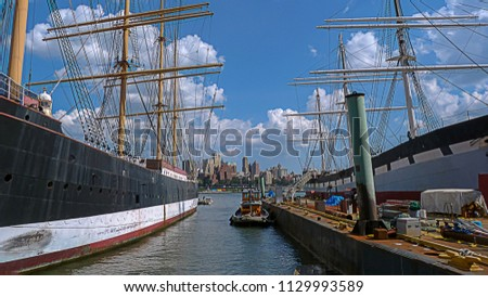 a42671114c6 Sailboats and boats in Seaport in downtown Manhattan with the Brooklyn  skyline on the background