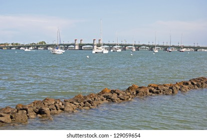 Sailboats cruising in the waters near a bridge in St. Augustine, Florida.