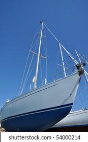 sailboats in a dockyard