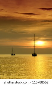 Sailboats at dusk. Tropical landscape.