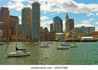 Sailboats in front of the skyline of Financial District in Boston, the United States. The city was founded in 1630 by Puritan settlers who came from England. The city is one of the oldest in the US.