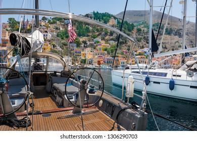 Sailboats in harbor town of Symi (Symi Island, Greece)
