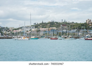 Sailboats in harbour with waterfront architecture in Noumea, New Caledonia/Sailboats in Noumea/NOUMEA, NEW CALEDONIA-NOVEMBER 25,2016: Sailboats anchored with architecture in Noumea, New Caledonia