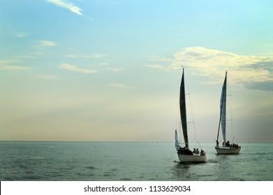 Sailboats in Lake Michigan at dusk