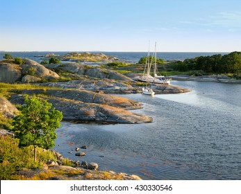 Sailboats moored at small rocky island in the outer part of the archipelago of Stockholm, Sweden (Ut-Fredlarna)