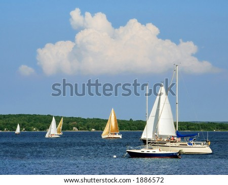 Sailboats on the blue water of Grand Traverse Bay, Michigan