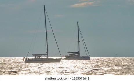 Sailboats on the coast of Croatia in front of the city Porec