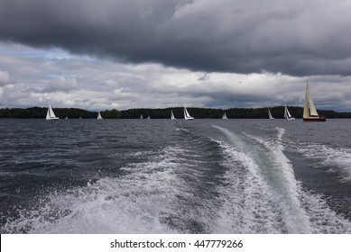 Sailboats on the lake on a windy day.Stormy weather.Summer travel.