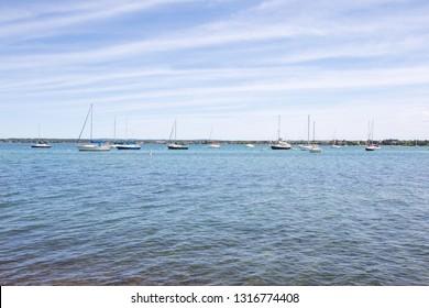 Sailboats on west grand traverse bay; Traverse City, Michigan