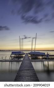 sailboats rest on lake monona at sunset