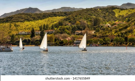 Sailboats sail in Westlake lake in Westlake Village, an upscale community in southern California.