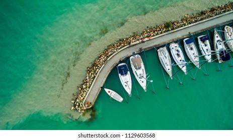 Sailboats and small yachts anchored at Lake Balaton, Hungary. Aerial view.