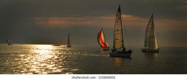 Sailboats at sunset.