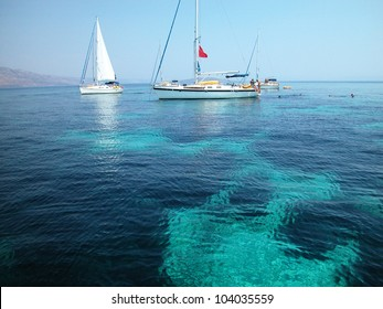 Sailboats surfing Mediterranean sea in Croatia