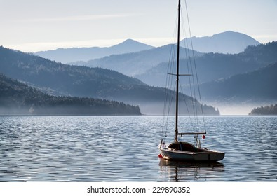 sailboats at the walchen lake in germany in front of the european alps