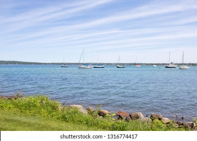 Sailboats in west grand traverse bay; traverse city, michigan