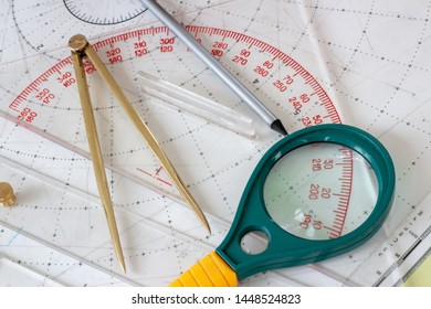 Sailer accessories for navigation in the sea. Сalipers, protractor, magnifier, map with coordinates