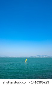 A sailer in the blue waters on Hong Kong