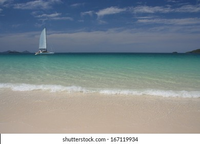 Sailing along sandy beach
